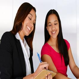 Young adult woman and teen smiling